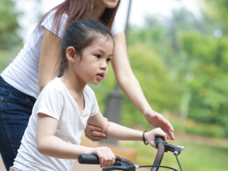Child Learning to Ride a Bike