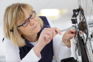 Woman Fixing Bike