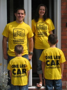 Family Wearing Campaign T-shirts in Different Sizes