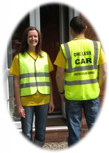 Couple Wearing Campaign Tabards in Different Sizes